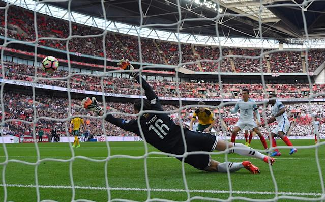 <p>Defoe slots home the opening goal for England on his return to international football </p>