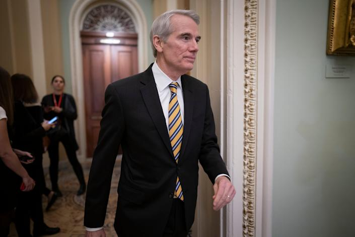 Sen. Rob Portman, R-Ohio, arrives as the impeachment trial of President Donald Trump on charges of abuse of power and obstruction of Congress resumes in Washington. Pressure is increasing on a Trump administration official to authorize a formal transition process for President-elect Joe Biden. Portman of Ohio on Monday, Nov. 23, called for the head of the General Services Administration to release money and staffing needed for the transition. (AP Photo/J. Scott Applewhite, File) (AP)
