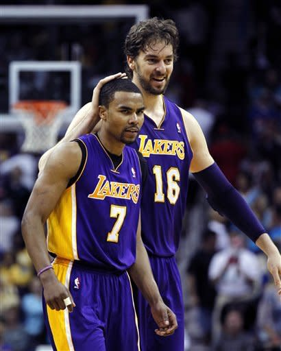 Los Angeles Lakers power forward Pau Gasol (16) congratulates point guard Ramon Sessions (7) after he hit a three point shot to extend the Lakers lead late in the in the second half of an NBA basketball game against the New Orleans Hornets in New Orleans, Monday, April 9, 2012. The Lakers won 93-91. (AP Photo/Gerald Herbert)