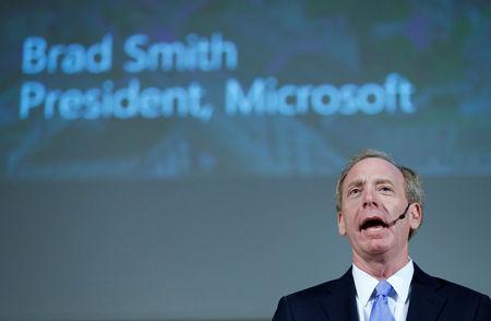 """FILE PHOTO: Brad Smith, President and Chief Legal Officer of Microsoft takes part in a panel discussion """"Cyber, big data and new technologies. Current Internet Governance Challenges: What's Next ?"""" at the United Nations in Geneva, Switzerland November 9, 2017. REUTERS/Denis Balibouse/File Photo"""