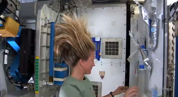 NASA astronaut Karen Nyberg shows how she washes her hair in space in this still from a video recorded on the International Space Station and uploaded online on July 9, 2013.