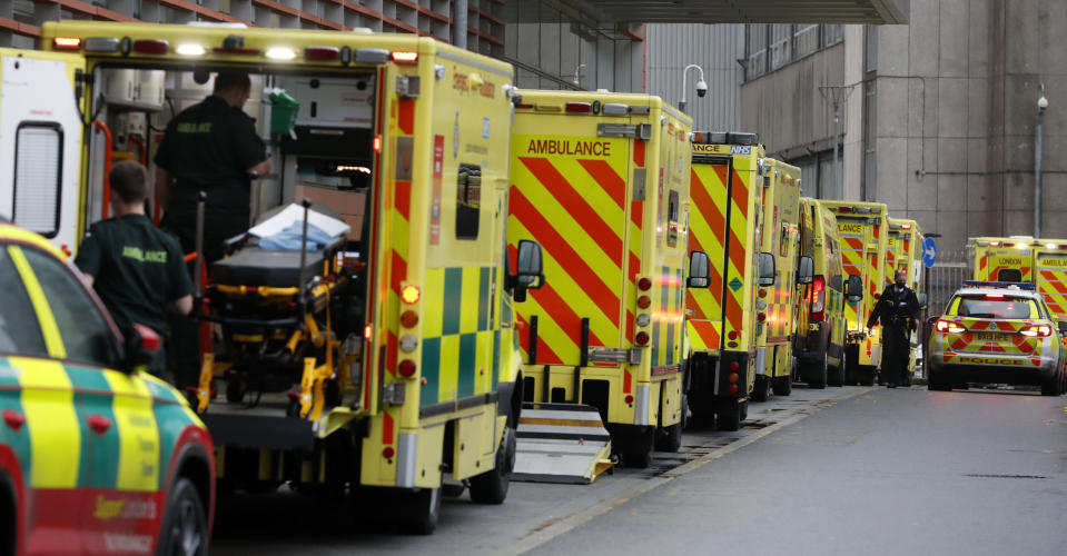 Ambulances queue at the Royal London Hospital in London, Wednesday, Jan. 13, 2021 during England's third national lockdown to curb the spread of coronavirus. (AP Photo/Alastair Grant)