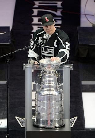 LOS ANGELES, CA - JUNE 16: Dustin Brown #23 of the Los Angeles Kings addresses the crowd during the Los Angeles Kings Victory Parade And Rally on June 16, 2014 in Los Angeles, California. (Photo by Harry How/Getty Images)