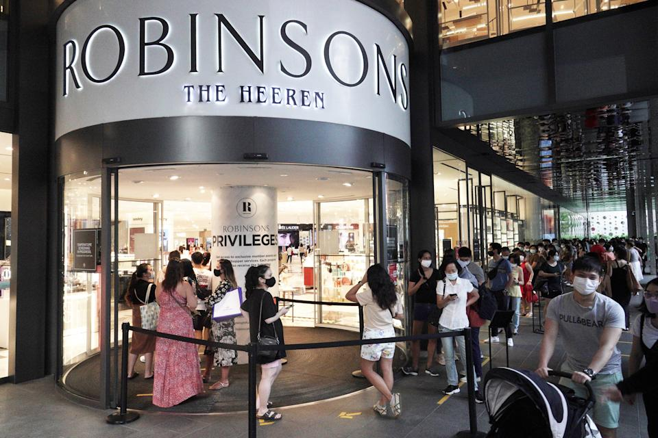 SINGAPORE, Oct. 30, 2020 -- Shoppers queue to enter the Robinsons department store at Heeren in Singapore on Oct. 30, 2020. The 162-year-old Robinsons announced the closing of its last 2 stores in Singapore, and will be exiting the retail scene. (Photo by Then Chih Wey/Xinhua via Getty) (Xinhua/Then Chih Wey via Getty Images)