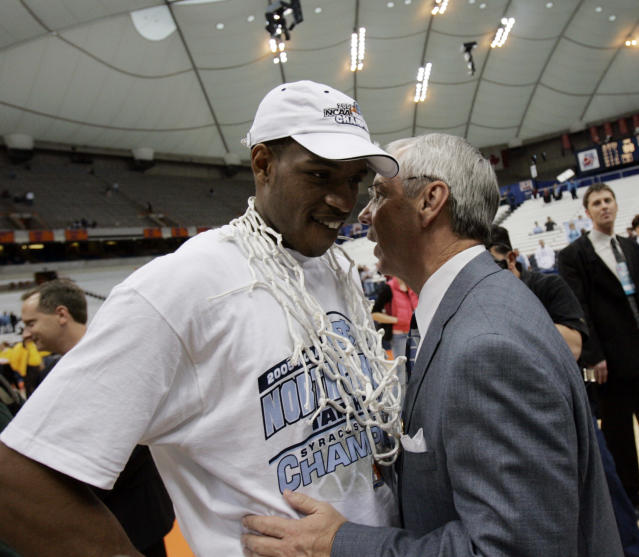 North Carolina coach Roy Williams chats with Rashad McCants after defeating Wisconsin 88-82 to win the NCAA East Regional in Syracuse, N.Y Sunday, March 27, 2005. (AP Photo/David Duprey)
