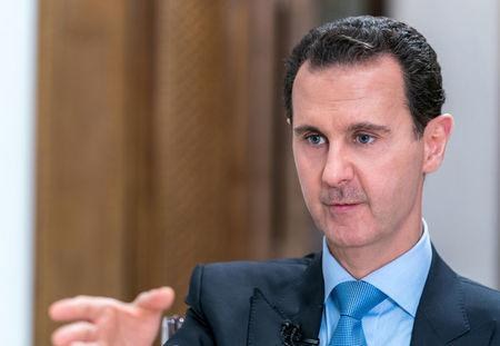 Syrian President Bashar al-Assad gestures during an interview with Iranian channel al-Alam News in Damascus, Syria in this handout released on June 13, 2018. SANA/Handout via REUTERS