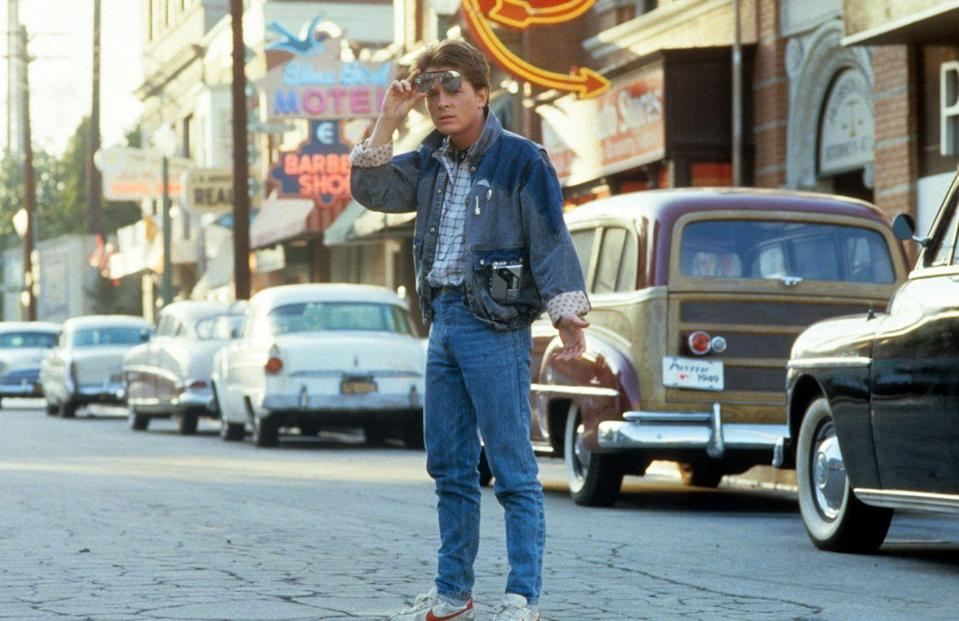 <p>There was never a more classic '80s look than Marty McFly himself. Michael J. Fox was simply iconic in his <em>Back to the Future </em>ensemble<em>—</em> high rise jeans, white Nike sneakers and a matching denim jacket. Oh, and don't forget the patterned lining, two-toned wash and popped collar. Can we go back in time for this look?</p>