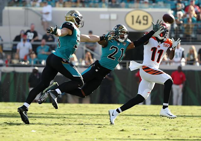 <p>Brandon LaFell #11 of the Cincinnati Bengals reaches for the football in front of Paul Posluszny and A.J. Bouye #21 of the Jacksonville Jaguars in the second half of their game at EverBank Field on November 5, 2017 in Jacksonville, Florida. (Photo by Logan Bowles/Getty Images) </p>
