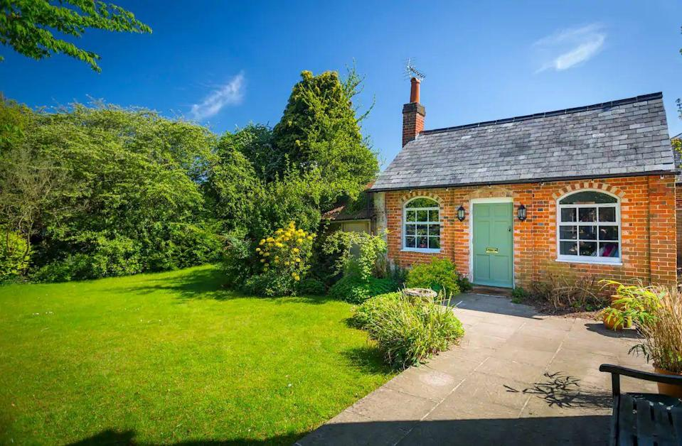 """<p>This cottage in the small village of Cheapside, just a mile from Ascot, sits within the host's private garden. It's as adorable inside as it appears from the outside and is an open-plan studio room with a sitting area, kitchenette, bedroom and en-suite. Perfect for a romantic break, the Old School House is a fantastic little hideaway, offering everything you need for a short break. </p><p><strong>Sleeps: </strong>2</p><p><strong>Price per night: </strong>£86</p><p><a class=""""link rapid-noclick-resp"""" href=""""https://airbnb.pvxt.net/kj0PBL"""" rel=""""nofollow noopener"""" target=""""_blank"""" data-ylk=""""slk:SEE INSIDE"""">SEE INSIDE</a></p>"""