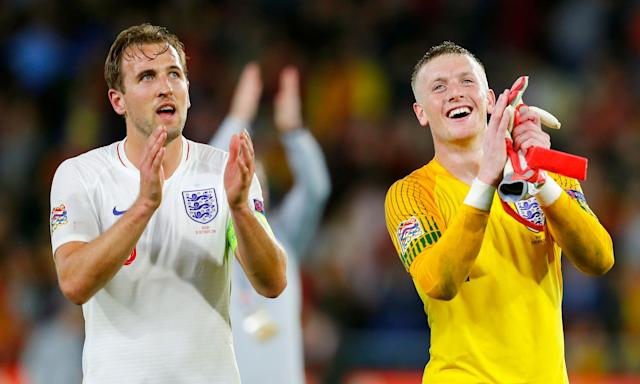 Harry Kane (left) and Jordan Pickford applaud the fans after England's victory against Spain Seville.
