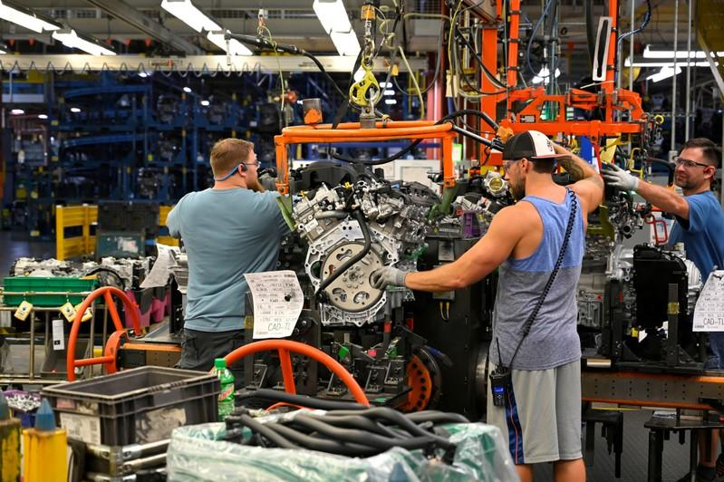 FILE PHOTO: Engines arrive on the assembly line at the General Motors (GM) manufacturing plant in Spring Hill