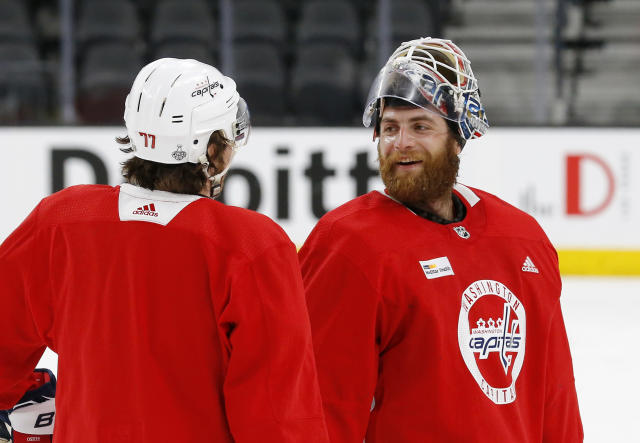 Washington Capitals goaltender Braden Holtby, right, talks with right wing T.J. Oshie during practice Tuesday, May 29, 2018, in Las Vegas. Game 2 of the Stanley Cup NHL hockey finals between the Capitals and the Vegas Golden Knights is scheduled for Wednesday. (AP Photo/Ross D. Franklin)