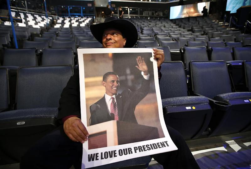 Delegate Gus Mansour, of Lynnwood, Wash. holds a poster of President Barack Obama at the Democratic National Convention in Charlotte, N.C., Tuesday, Sept. 4, 2012. (AP Photo/Jae C. Hong)