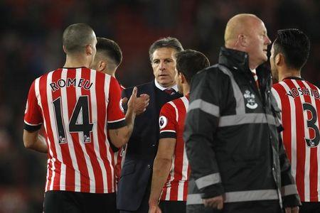 Southampton manager Claude Puel celebrates after the match with Southampton's Oriol Romeu and teammates