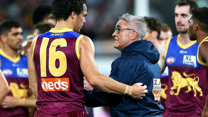 Cam Rayner and Chris Fagan are pictured speaking at three quarter time against the Gold Coast Suns.