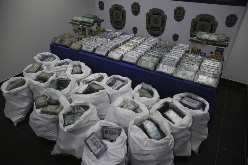 A large supply of cocaine recently seized is displayed to the press at the Portuguese police headquarters in Lisbon, Wednesday, Jan. 8, 2020. For the second time in twelve months, Portuguese police have discovered a large stash of cocaine concealed in a shipment of bananas from Latin America. (AP Photo/Armando Franca)