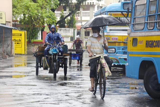 People in the streets during heavy rain due to cyclonic storm Amphan. (Photo by Ved Prakash/Pacific Press/LightRocket via Getty Images)