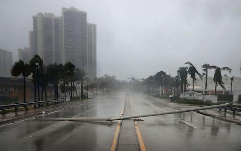 East Oakland Park Boulevard is completely blocked by a downed street light pole as Hurricane Irma hits the southern part of the state - Credit: Getty