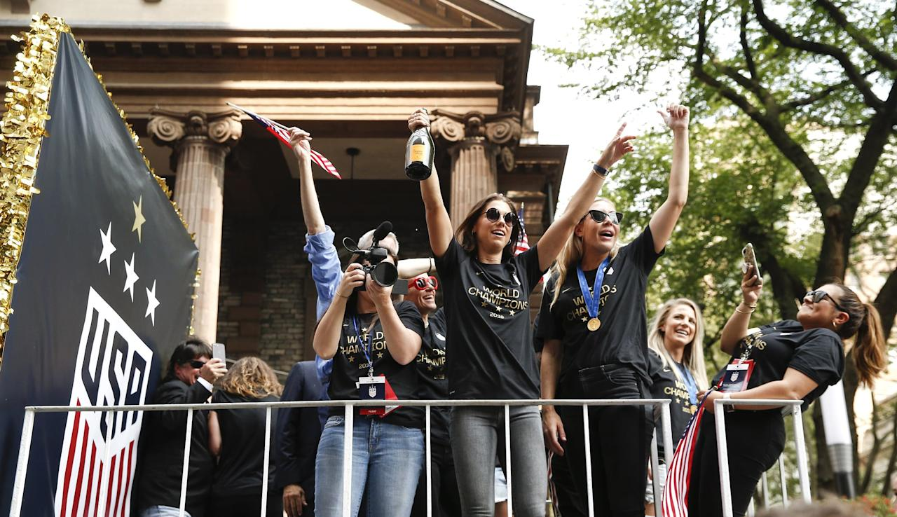 """<p>The USWNT <a href=""""https://www.popsugar.com/fitness/US-Women-Soccer-Team-Ticker-Tape-Parade-Photos-46360443"""" class=""""ga-track"""" data-ga-category=""""Related"""" data-ga-label=""""https://www.popsugar.com/fitness/US-Women-Soccer-Team-Ticker-Tape-Parade-Photos-46360443"""" data-ga-action=""""In-Line Links"""">took their World Cup celebrations to another level</a>, and it was a joy to watch. Grab a Champagne bottle and a replica World Cup trophy to nail this casual look by <a href=""""https://www.popsugar.com/fitness/Who-Alex-Morgan-46131760"""" class=""""ga-track"""" data-ga-category=""""Related"""" data-ga-label=""""https://www.popsugar.com/fitness/Who-Alex-Morgan-46131760"""" data-ga-action=""""In-Line Links"""">Alex Morgan</a>. (Bonus: grab a couple of friends and make it a group costume of the whole team!)</p> <ul> <li> <a href=""""https://www.popsugar.com/buy/US-Women-Soccer-Team-World-Cup-Champions-T-Shirt-497387?p_name=US%20Women%27s%20Soccer%20Team%20World%20Cup%20Champions%20T-Shirt&retailer=amazon.com&pid=497387&price=20&evar1=fit%3Auk&evar9=46707845&evar98=https%3A%2F%2Fwww.popsugar.com%2Ffitness%2Fphoto-gallery%2F46707845%2Fimage%2F46708980%2FAlex-Morgan-at-Ticker-Tape-Parade&prop13=api&pdata=1"""" rel=""""nofollow"""" data-shoppable-link=""""1"""" target=""""_blank"""" class=""""ga-track"""" data-ga-category=""""Related"""" data-ga-label=""""https://www.amazon.com/US-Womens-Soccer-Team-Wins/dp/B07V8N9YH7"""" data-ga-action=""""In-Line Links"""">US Women's Soccer Team World Cup Champions T-Shirt</a> ($20)</li> <li>Champagne</li> <li> <a href=""""https://www.popsugar.com/buy/World-Cup-Trophy-Replica-497388?p_name=World%20Cup%20Trophy%20Replica&retailer=amazon.com&pid=497388&price=83&evar1=fit%3Auk&evar9=46707845&evar98=https%3A%2F%2Fwww.popsugar.com%2Ffitness%2Fphoto-gallery%2F46707845%2Fimage%2F46708980%2FAlex-Morgan-at-Ticker-Tape-Parade&prop13=api&pdata=1"""" rel=""""nofollow"""" data-shoppable-link=""""1"""" target=""""_blank"""" class=""""ga-track"""" data-ga-category=""""Related"""" data-ga-label=""""https://www.amazon.com/HTYX-Champion-Souvenirs-Corrosion-Resistant/dp/B07V35S1TL"""" d"""