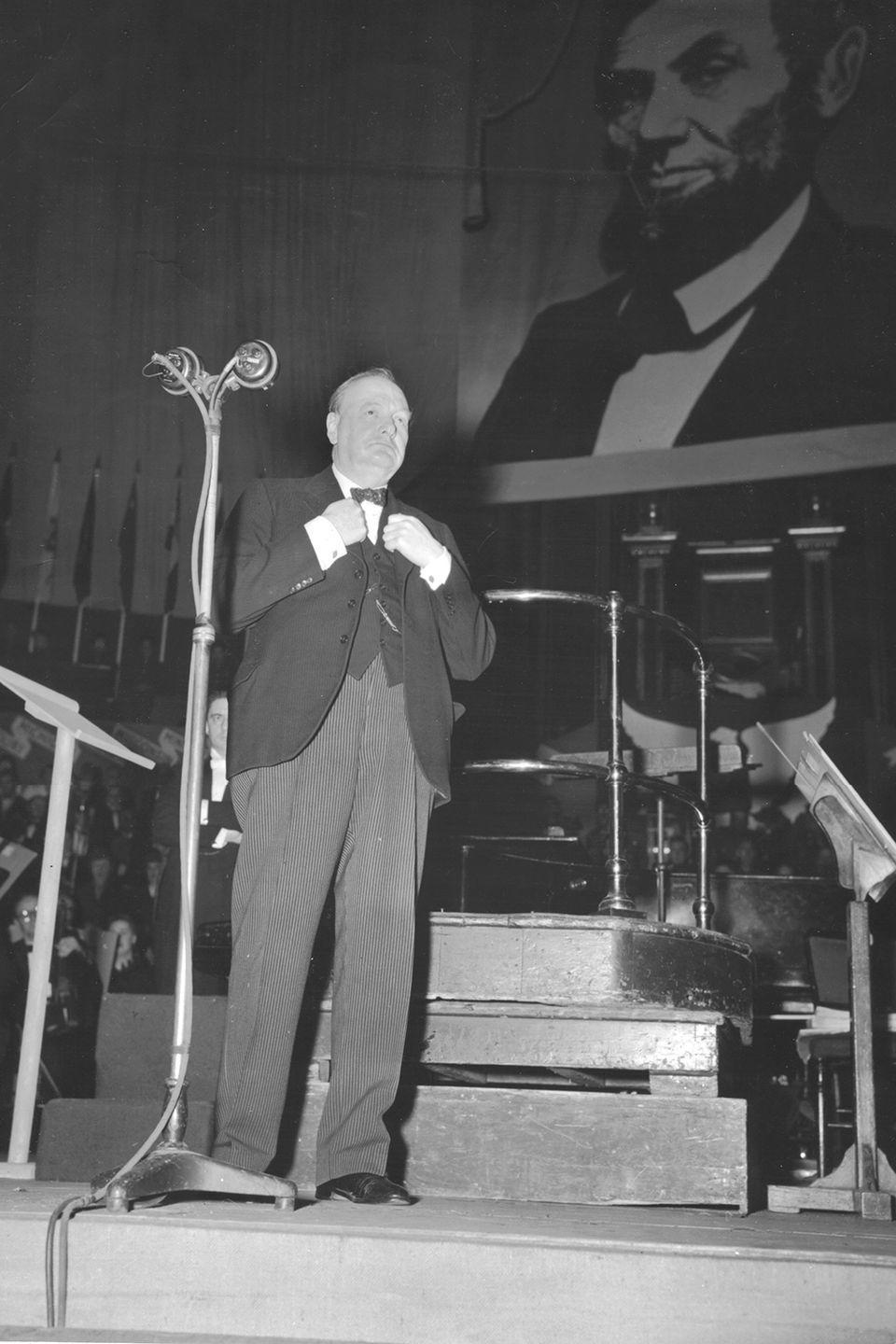 <p>British Prime Minister Winston Churchill addressed an American audience in London in a memorable Thanksgiving tribute to the millions of soldiers and civilians who lost their lives during World War II.</p>