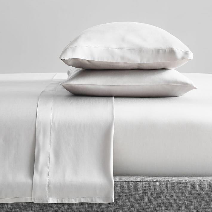 """<p><strong>West Elm</strong></p><p>westelm.com</p><p><strong>$140.00</strong></p><p><a href=""""https://go.redirectingat.com?id=74968X1596630&url=https%3A%2F%2Fwww.westelm.com%2Fproducts%2Ftencel-sheet-set-b2105&sref=https%3A%2F%2Fwww.cosmopolitan.com%2Fhealth-fitness%2Fg35031720%2Fhow-to-sleep-better%2F"""" rel=""""nofollow noopener"""" target=""""_blank"""" data-ylk=""""slk:Shop Now"""" class=""""link rapid-noclick-resp"""">Shop Now</a></p><p>Can't sleep? Try changing your sheets. This set is made from moisture-wicking Tencel fabric, which is made from eucalyptus fibers. Not only is it super-soft, but it stays super-cool throughout the night — perfect for those who keep kicking the covers off for being too hot.</p><p>This collection from West Elm is available in five silky shades, and the set comes with a flat sheet, a fitted sheet, and two pillow cases. </p>"""