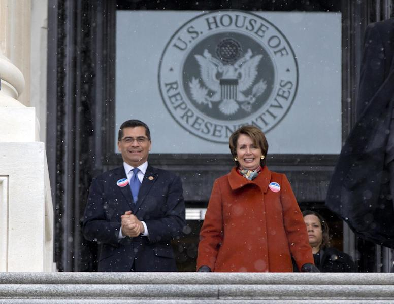 Rep. Xavier Becerra, D-Calif., left, and House Minority Leader Nancy Pelosi of Calif., walk with other House Democrats and immigration leaders to gather on the steps of the Capitol in Washington, Wednesday, March 26, 2014, for a new conference in Washington to announce a DemandAVote discharge petition and call on House Speaker John Boehner of Ohio, and the House Republican Conference to bring up immigration reform bill H.R. 15. (AP Photo/Carolyn Kaster)