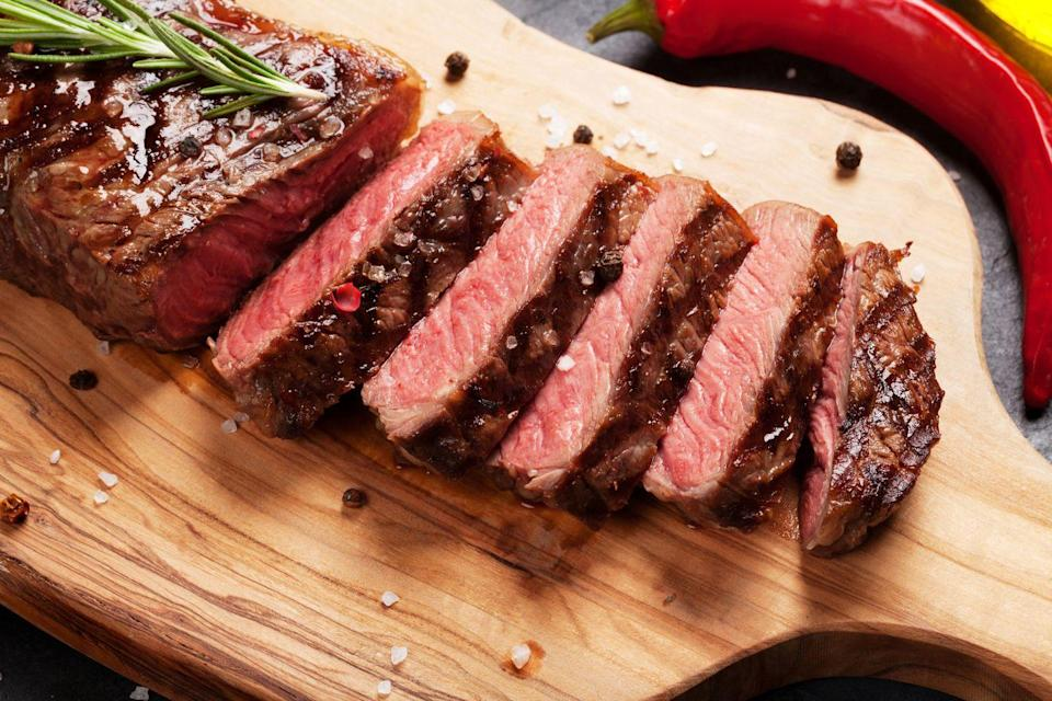 """<p>Aim to integrate more plant-based proteins, such as beans and nuts, for the biggest heart health boost. """"Red meat consumption has been shown to increase cardiovascular risk,"""" Rivera says.</p><p>A <a href=""""https://academic.oup.com/eurheartj/advance-article-abstract/doi/10.1093/eurheartj/ehy799/5232723?redirectedFrom=fulltext"""" rel=""""nofollow noopener"""" target=""""_blank"""" data-ylk=""""slk:2018 study"""" class=""""link rapid-noclick-resp"""">2018 study</a> from the <em>European Heart Journal</em> may point to why. Compared to white meat or <a href=""""https://www.prevention.com/food-nutrition/healthy-eating/g26895324/complete-protein-foods-list/"""" rel=""""nofollow noopener"""" target=""""_blank"""" data-ylk=""""slk:vegetarian protein sources"""" class=""""link rapid-noclick-resp"""">vegetarian protein sources</a>, red meat triggers the body to produce more of the gut bacteria trimethylamine N-oxide (TMAO) during digestion. High amounts of TMAO in the body has been associated with increased risk for <a href=""""https://www.prevention.com/health/health-conditions/g26112313/heart-attack-symptoms-women/"""" rel=""""nofollow noopener"""" target=""""_blank"""" data-ylk=""""slk:heart attacks"""" class=""""link rapid-noclick-resp"""">heart attacks</a> and stroke, according to the Cleveland Clinic.</p>"""