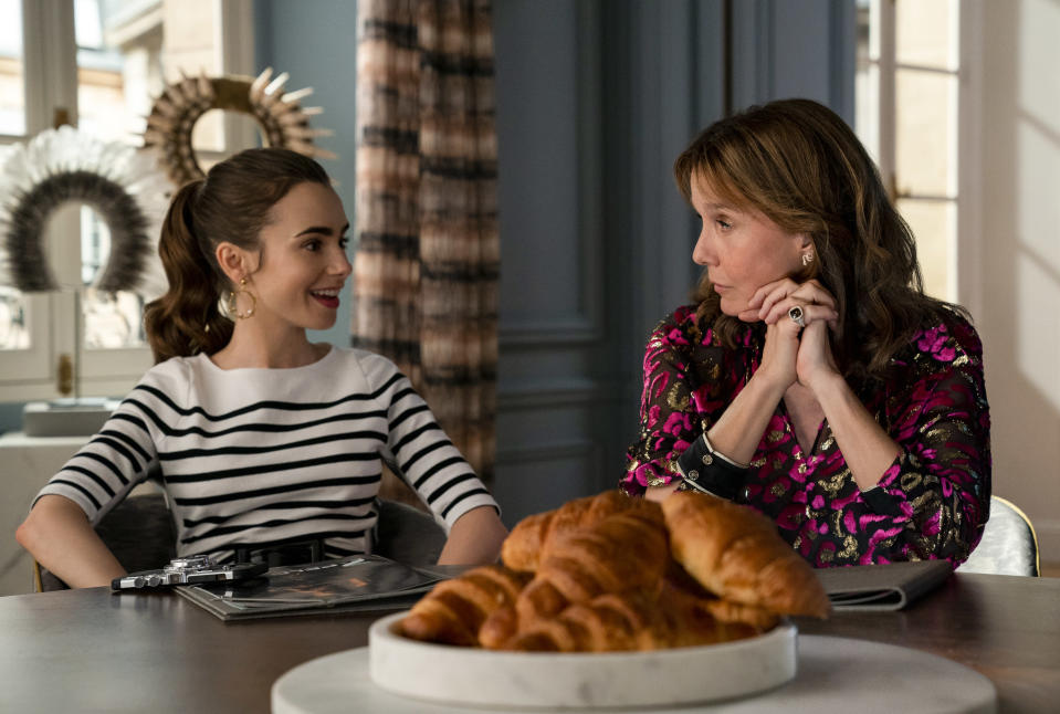 Emily in Paris. (L to R) Lily Collins as Emily, Philippine Leroy-Beaulieu as Sylvie in episode 207 of Emily in Paris. Cr. Stéphanie Branchu/Netflix © 2021