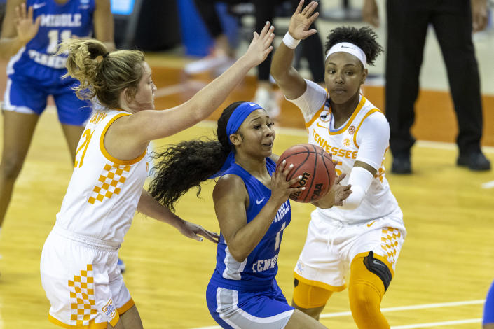 Middle Tennessee State guard Anastasia Hayes, center, drives to the basket between Tennessee guard Tess Darby and guard Jordan Horston during the first half of a college basketball game in the first round of the women's NCAA basketball tournament at the Frank Erwin Center in Austin, Texas, Sunday, March 21, 2021. (AP Photo/Stephen Spillman)