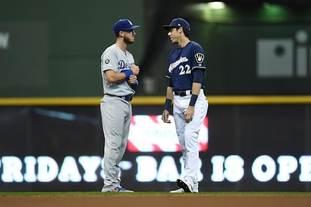Cody Bellinger and Christian Yelich met on the field early in 2019, then raced toward an NL MVP vote throughout the season. (Photo by Stacy Revere/Getty Images)