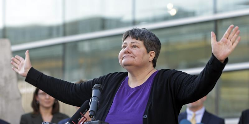 """Plaintiff Kate Call addresses at crowd gathered at the Utah Unites for Marriage """"send-off"""" event Monday, April 7, 2014, in Salt Lake City. On Wednesday, April 9, 2014, a three-judge panel in Denver will become the first federal appeals court to hear arguments regarding state same-sex marriage bans since the Supreme Court ruling in June that overturned part of a federal ban on gay marriage. A series of pro-gay marriage rulings in the previous nine months by federal judges has emboldened backers of gay marriage and spurred predictions that it's only a matter of time before gay and lesbian couples will be able to legally marry across the United States. (AP Photo/Rick Bowmer)"""