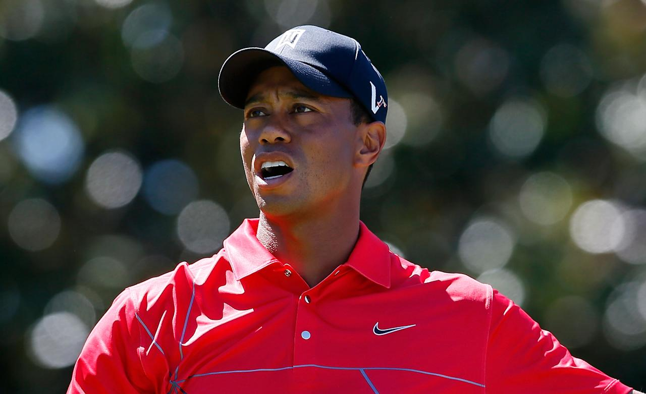 ATLANTA, GA - SEPTEMBER 23:  Tiger Woods reacts to a poor tee shot on the fifth hole during the final round of the TOUR Championship by Coca-Cola at East Lake Golf Club on September 23, 2012 in Atlanta, Georgia.  (Photo by Kevin C. Cox/Getty Images)