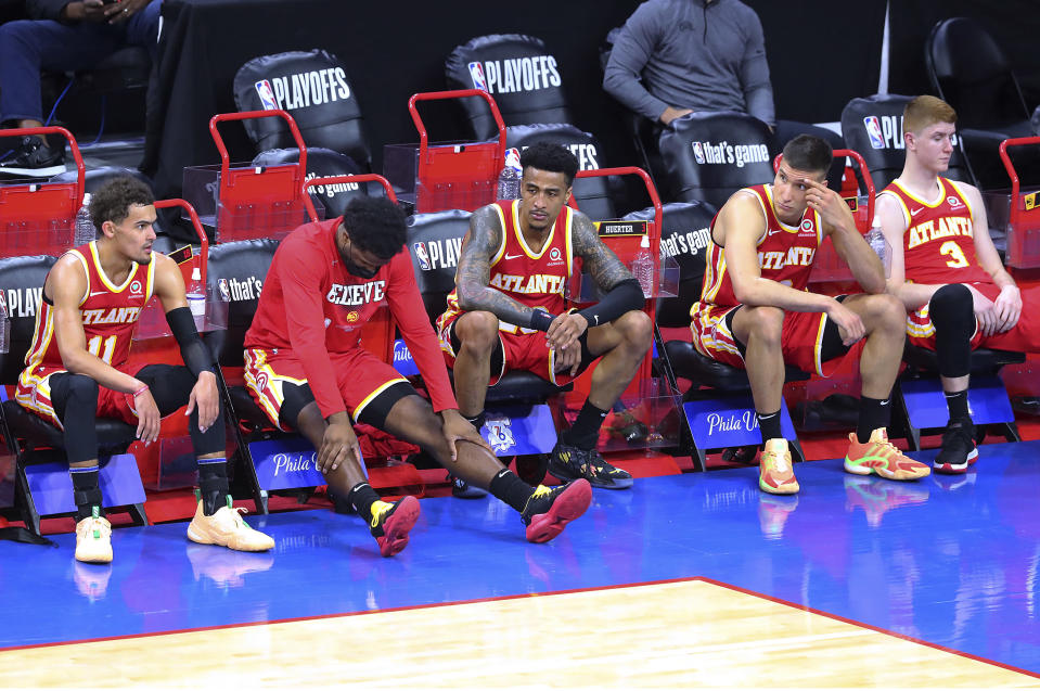 Atlanta Hawks' Trae Young, Solomon Hill, John Collins, Bogan Bogdanovic and Kevin Huerter, from left, sit on the bench in the final minute of the team's 118-102 loss to the Philadelphia 76ers in Game 2 of an NBA basketball Eastern Conference semifinal series Tuesday, June 8, 2021, in Philadelphia. (Curtis Compton/Atlanta Journal-Constitution via AP)