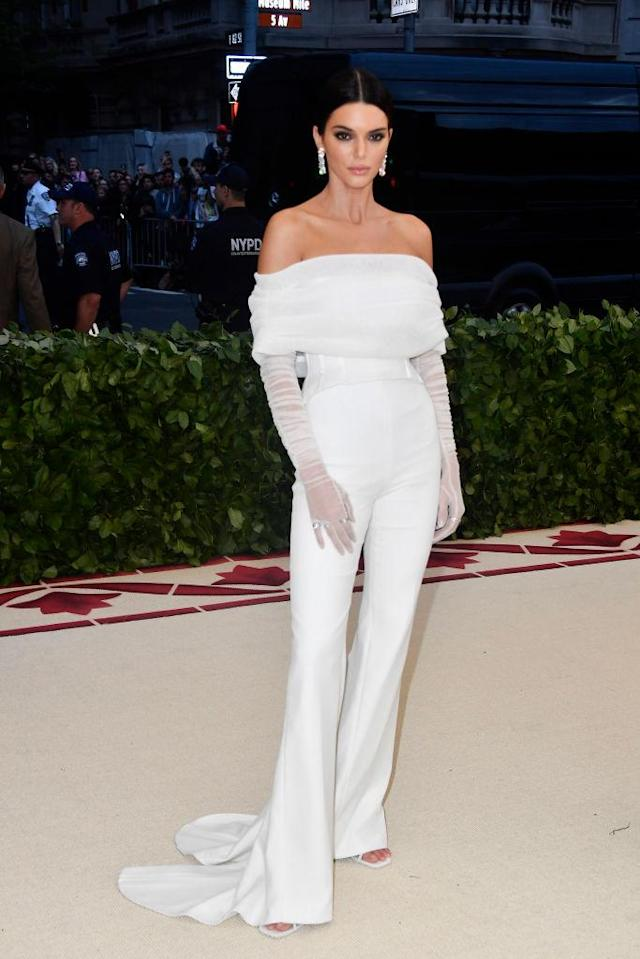 <p>Jenner embodied bride goals in an all-white jumpsuit by Off-White. (Photo: Getty Images) </p>