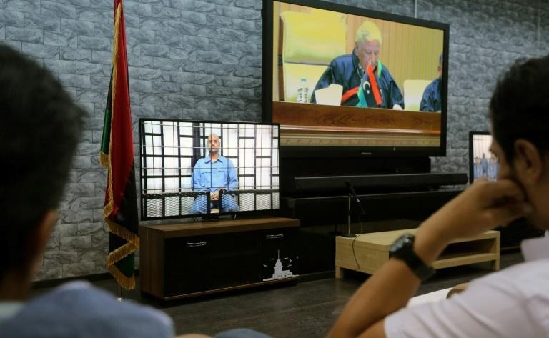 Seif al-Islam (L) has not been seen or heard from since June 2014, when he appeared via video from Zintan during his trial by a Tripoli court