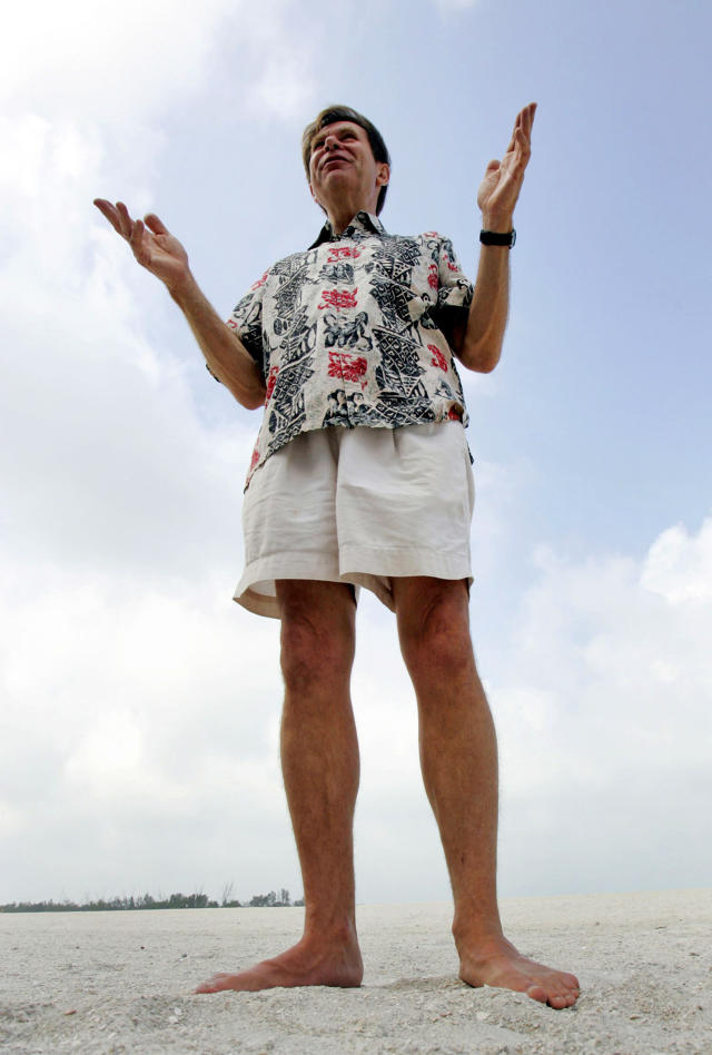 """FILE - In this May 25, 2005, file photo, international beach expert Stephen Leatherman, aka """"Dr. Beach,"""" goes barefoot on Fort De Soto's north beach in Tierra Verde, Fla. Leatherman released his 2019 list of the 10 best beaches in the U.S., Thursday, May 23, 2019. (AP Photo/Chris O'Meara, File)"""