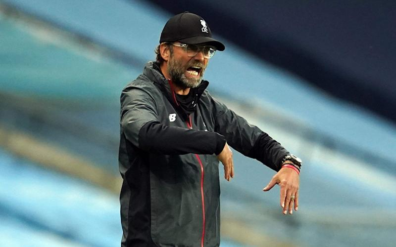 Liverpool's German manager Jurgen Klopp reacts from the sidelines during the English Premier League - AFP