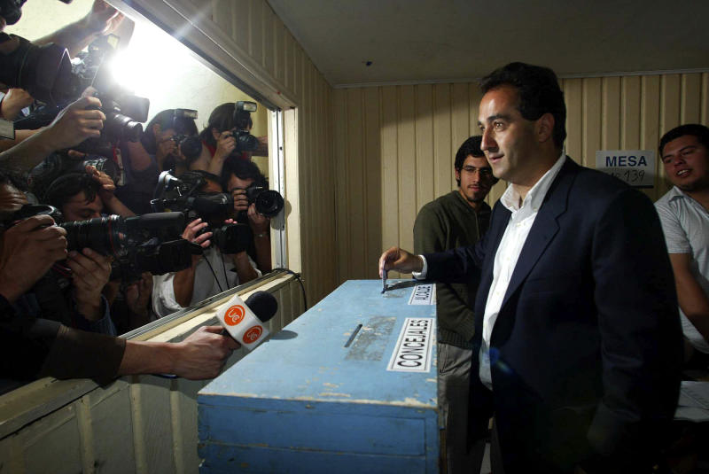FILE - In this Oct. 26, 2008 file photo, candidate for mayor of Santiago, Pablo Zalaquett, casts his ballot in a polling station in Santiago. Zalaquett, who is running for reelection on Oct. 28, 2012, of the right-wing UDI party, faces Carolina Toha. (AP Photo/Hector Retamal, La Tercera, File)