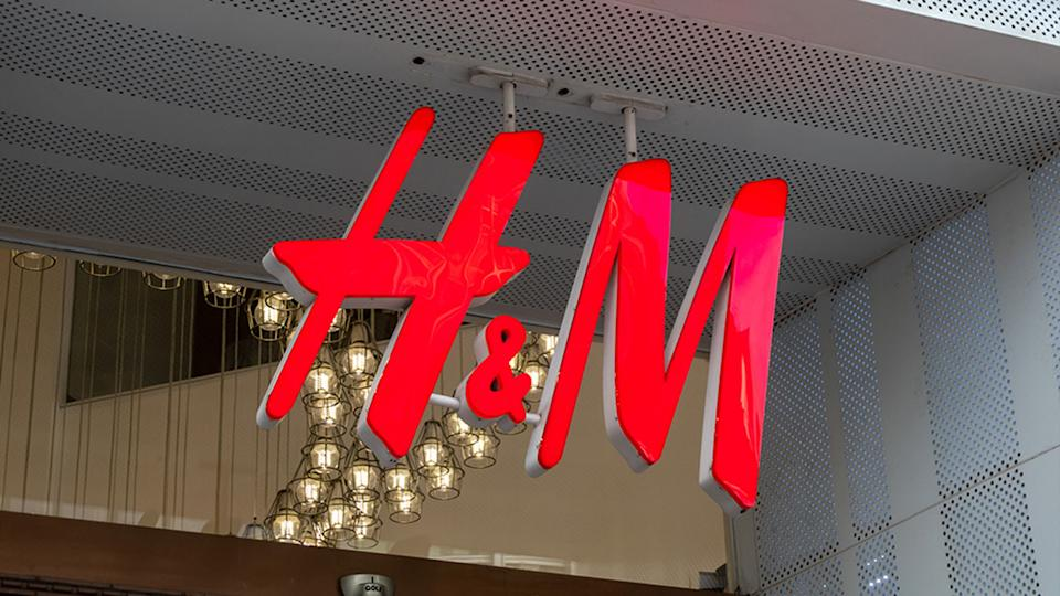 H&M logo hangs on display outside a H&M store on Nanjing Road Pedestrian Street on March 24, 2021 in Shanghai, China.