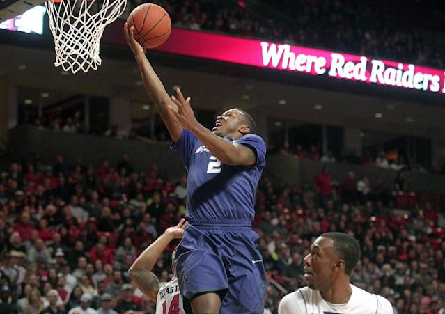Kansas State's Marcus Foster scores over Texas Tech's Robert Turner (14) and Jamal Williams, Jr.(23) during an NCAA college basketball game in Lubbock, Texas, Tuesday, Feb, 25, 2014. (AP Photo/Lubbock Avalanche-Journal, Stephen Spillman)