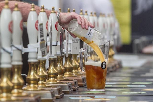 <p>A pint is poured into a pitcher at the Great British Beer Festival, August 8, 2017 in London, England. (Photo: Amer Ghazzal/REX/Shutterstock) </p>
