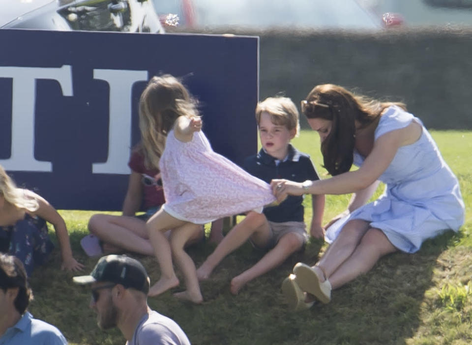 Kate ensured Charlotte didn't run too far and kept a grip on her dress when required [Photo: Getty]