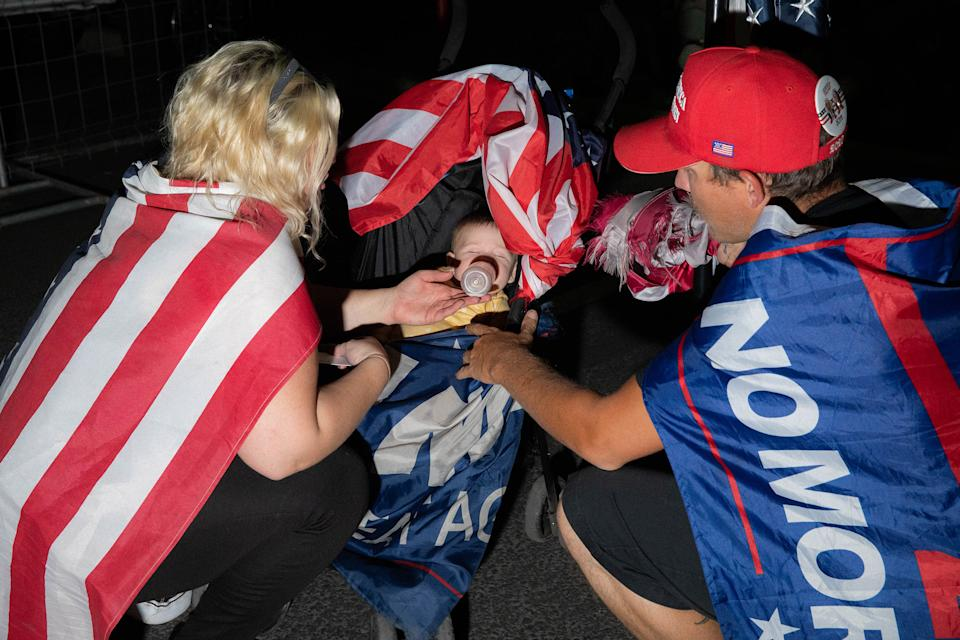 """Andrew Germana and Jenna Colley feed their baby at the Maricopa County Elections office in Phoenix, on Nov. 5<span class=""""copyright"""">Sinna Nasseri for TIME</span>"""