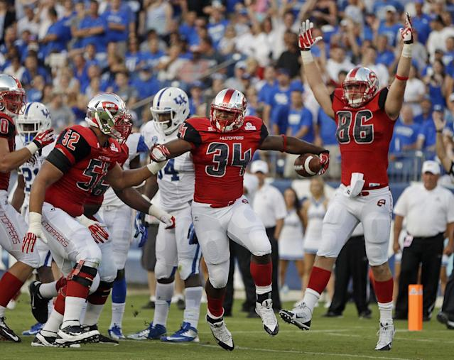 Western Kentucky running back Keshawn Simpson (34) celebrates with Cameron Clemmons (52) and Tim Gorski (86) after Simpson scored a touchdown on a 3-yard run against Kentucky in the first quarter of an NCAA college football game on Saturday, Aug. 31, 2013, in Nashville, Tenn. (AP Photo/Mark Humphrey)