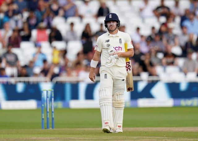Rory Burns walks off after being dismissed