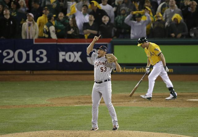 Detroit Tigers pitcher Joaquin Benoit (53) celebrates after getting Oakland Athletics' Seth Smith, rear, to fly out for the final out of the ninth inning of Game 5 of an American League baseball division series in Oakland, Calif., Thursday, Oct. 10, 2013. The Tigers won 3-0. (AP Photo/Jeff Chiu)