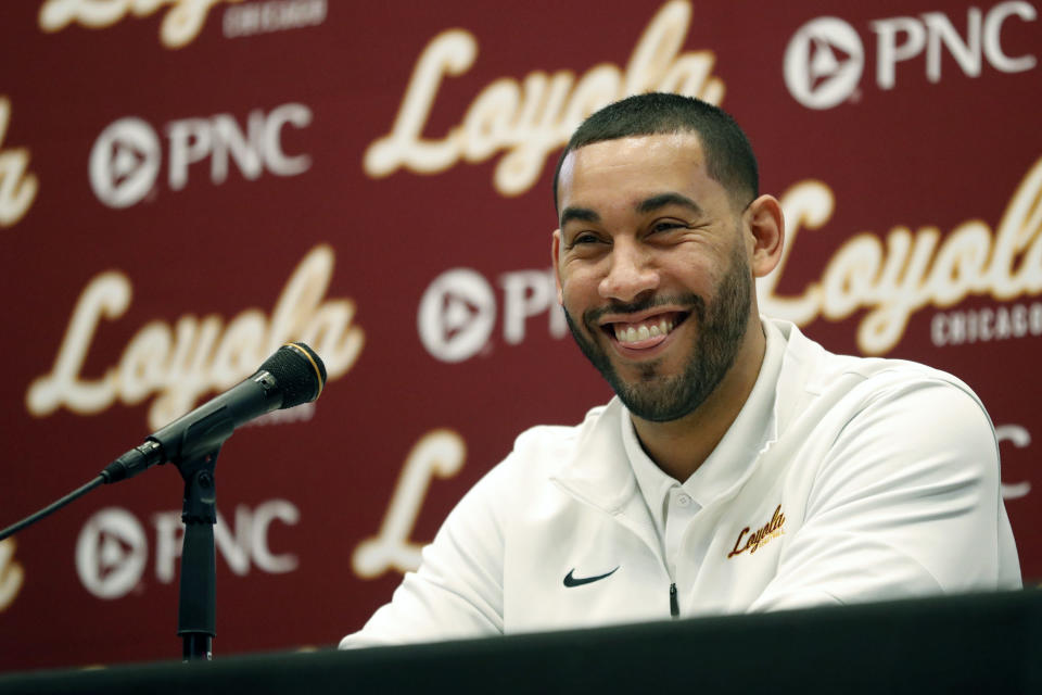 Drew Valentine smiles as he speaks during a press conference where he was introduced as Loyola University's new men's NCAA college basketball head coach, Tuesday, April 6, 2021, in Chicago. (AP Photo/Shafkat Anowar)