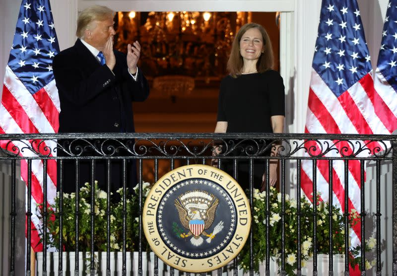 FILE PHOTO: Judge Amy Coney is sworn in as an associate justice of the U.S. Supreme Court at the White House in Washington
