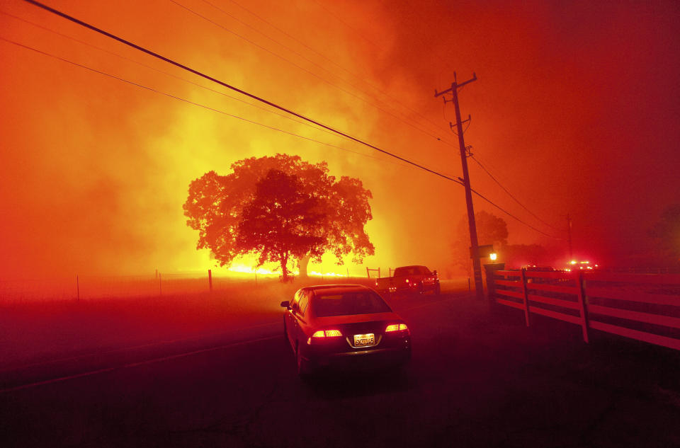 Residents flee as winds whip flames from the Morgan fire along Morgan Territory Road near Clayton, California in unincorporated Contra Costa County September 9, 2013. The blaze, burning in dense, dry scrub, grass and timber in and around Mount Diablo State Park, had scorched some 3,700 acres (1,500 hectares) by Monday afternoon, forcing the evacuation of about 100 homes at the edge of the town of Clayton. REUTERS/Noah Berger (UNITED STATES - Tags: DISASTER ENVIRONMENT SOCIETY TPX IMAGES OF THE DAY)