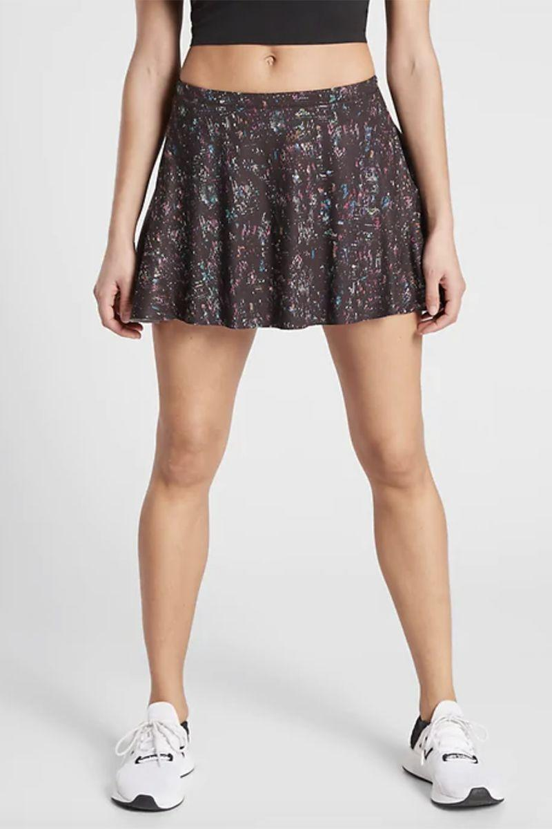 """<p><strong>Athleta</strong></p><p>athleta.gap.com</p><p><strong>$33.97</strong></p><p><a href=""""https://go.redirectingat.com?id=74968X1596630&url=https%3A%2F%2Fathleta.gap.com%2Fbrowse%2Fproduct.do%3Fpid%3D531326012%26pcid%3D999%26vid%3D1%26searchText%3Dskort%23pdp-page-content&sref=https%3A%2F%2Fwww.marieclaire.com%2Ffashion%2Fg33310213%2Fexercise-skorts%2F"""" rel=""""nofollow noopener"""" target=""""_blank"""" data-ylk=""""slk:SHOP IT"""" class=""""link rapid-noclick-resp"""">SHOP IT</a></p><p>This printed skort is made for medium to high-impact workouts at the gym or outdoors. If you're looking for an athletic piece with a fun print and plenty of stash space (this skort has <em>five</em> pockets!), the search ends here. Add to your checkout cart ASAP.</p>"""